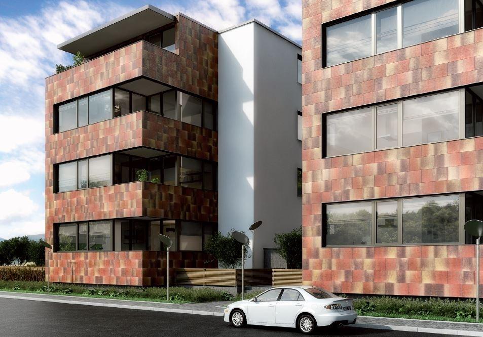 Systém odvětrávané fasády s betonovými obkladovými fasádními deskami s fotokatalytickými vlastnostmi
