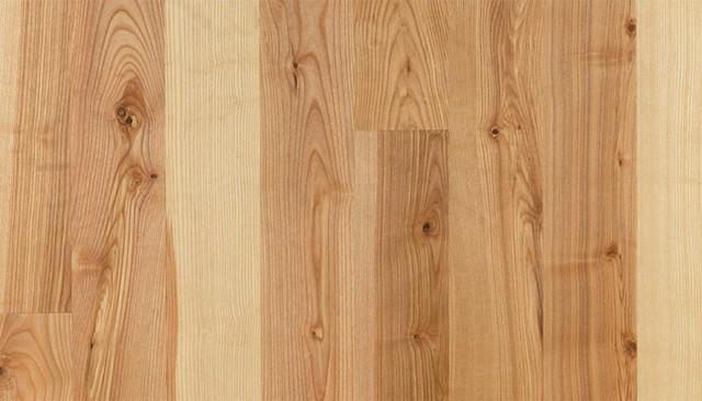 Rustikální podlahy jsou velmi oblíbené právě díky vyššímu podílu suků, na obrázku jasanová podlaha FeelWood rustikal