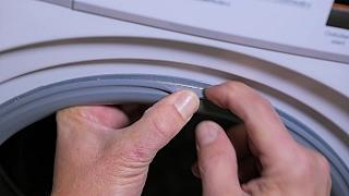 Oprava protékající těsnící gumy pračky